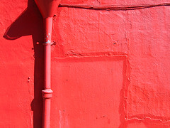 that wall (fotogail) Tags: sanfrancisco red wall paint shadows pipe guesswheresf foundinsf fotogail yourtop60interestingfaves2006thanks gail:williams=2006