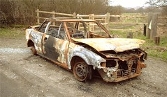 A burnt out car (Bay M) Tags: uk winter car fire rust rover crime vandalism stolen wreck emergency carpark burntout ipswich bobbits richardwisbey