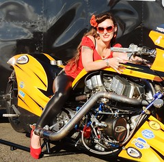 Holly_9899 (Fast an' Bulbous) Tags: supertwin nitro veetwin harleydavidson top fuel bike motorcycle biker chick babe girl woman hot sexy sunglasses long brunette hair legs red shoes high heels stilettos tight leather jeans pvc leggings model pose pinup people outdoor nikon drag santa pod england race track strip pits