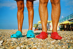 there taking over the world! (lomokev) Tags: blue red people color feet beach shoes brighton legs stones low neil plastic contax croc knees agfa ultra flick t2 agfaultra crocs contaxt2 ratseyeview  deletetag eaglefestival grownd neilt rota:type=showall rota:type=portraits file:name=contax0806a03 use:on=moo eaglefestivalsmall