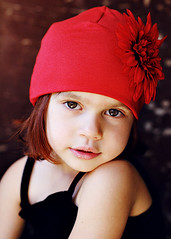 Girl in Red ({amanda}) Tags: red flower cute girl hat 50mm child naturallight brightred flowerhat babycappelli fourywears amandakeeysphotography