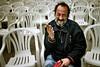 05CD28144 (Paulgi) Tags: red people white man portugal smile book chair europe 28mm viana minho paulgi top20street