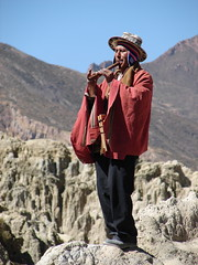 Pipe player at the Valley of the Moon (Alexander Yates) Tags: travel musician music man mountains latinamerica southamerica high altitude pipes pipe bolivia valledelaluna andes writer ethnic novelist valleyofthemoon andesmountains aymara mallasa montaasandinas travelwriter alexanderyates