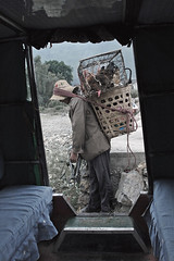 - heavy burden - (idogu) Tags: china light shadow woman colors market farmer dali muted shaping