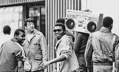 Boom Box - Montreal 1987 (Mikey G Ottawa) Tags: street blackandwhite bw white black blur sunglasses youth rural radio flow person photography frozen big aperture focus noir dof quebec folk expression montreal candid 1987 ottawa tide gang strangers streetphotography shades oldschool depthoffield example age question storefront surprise beat merchandise mistake s1 rap boombox merch storewindow bandw teach stroll speakers sweep learn turf merge strut volk mystuff gens ebb navigate improve nativepeople mikeyg theconsumerist mikeygottawa labellevilledemontreal mikesmoneyshot