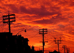 Electric Sky (Musical Mint) Tags: sunset red sky orange toronto colour topf25 silhouette electric night clouds wow amazing cool bright dusk awesome vivid lamppost redsky colourful electrical incredible electricsky electricalpoles helluva topc200 cotcmostfavorited onlythebest 1on1photooftheday musicalmint superaplus aplusphoto