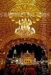 Golden Temple Lights (Raminder Pal Singh) Tags: world lighting travel people india water silhouette sunrise lights pond hands ancient shrine respect god prayer religion crowd entrance culture legendary divine sacred nectar fold sikh punjab spiritual amritsar sikhism mandir goldentemple acceptance openness gather obeisance thepca eminent darbarsahib harimandir ostensibly sarowar flickrplatinum
