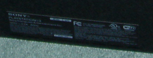 Close up of the FCC logo on US PS3