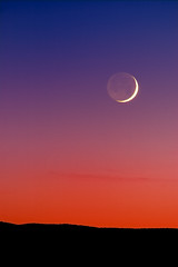 Grand Crescent Moon Sunset (Fort Photo) Tags: longexposure blue sunset red moon newmexico nature night dark landscape nikon bravo nightscape nocturnal d70 quality indigo first 2006 crescent nocturne socorro moonset afterdark crescentmoon earthshine magicdonkey 100faves 50faves 300f4 200faves outstandingshots specnature selectedasthebest specsky abigfave flickrgold bestnaturetnc06 anawesomeshot expd impressedbeauty diamondclassphotographer flickrdiamond