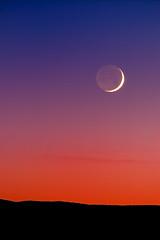 Grand Crescent Moon Sunset (Fort Photo) Tags: longexposure blue sunset red moon newmexico nature night dark landscape nikon bravo nightscape nocturnal d70 quality indigo first 2006 crescent nocturne socorro moonset afterdark crescentmoon earthshine magicdonkey 100faves 50faves 300f4 200faves outstandingshots specnature selectedasthebest specsky abigfave flickrgold bestnaturetnc06 anawesomeshot expd impressedbeauty diamondclassphotographer flickrdiamond