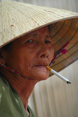 Smoking Granny (J Catlett) Tags: grandma portrait woman asian nikon asia seasia southeastasia vietnamese cigarette candid sigma smoking vietnam d200 smoker 70300mm saigon hochiminhcity hcmc indochine indochina nonla seasian nnl sept292006224