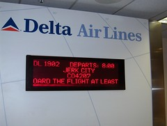 Now Boarding For Jerk City (Joe Shlabotnik) Tags: 2005 sign airport delta jacksonville flights june2005 jerk faved jerkcity explored heylookatthis
