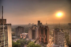 Connaught Place sunset (wili_hybrid) Tags: city travel november winter sunset urban sun india holiday geotagged restaurant photo yahoo smog high bravo asia flickr downtown cityscape rooftops dynamic photos delhi indian picture pic 2006 journey vista wikipedia imaging mapping range geotag tone hdr hdri parikrama connaught connaughtplace photomatix tonemapped tonemapping year2006 highdynamicrangeimaging