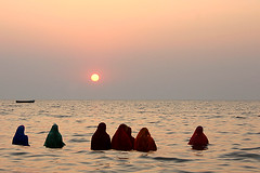 Sun and Sea (Ashish T) Tags: sea woman sun india beach festival river worship asia indian horizon mumbai juhu bihar chath bihari ashisht ashishtibrewal lpfestasiapacific