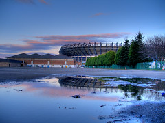 Murrayfield Stadium, Edinburgh, in the evening. (Semi-detached) Tags: blue light flower reflection puddle evening scotland edinburgh rugby stadium murrayfield union scottish haymarket capacity soctland seater supershot