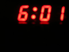 wake up. take exactly one minute to turn on camera and take picture of clock.