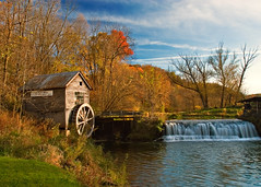 Old Hyde Mill (Todd Klassy) Tags: lighting wood old travel autumn trees sky orange house color colour green fall mill tourism water leaves wheel wisconsin clouds forest river landscape outdoors waterfall spring woods scenery rocks stream afternoon postcard country bluesky nobody landmark historic falling autumncolors journey serene ripples roadside lovely roadsideattraction majestic idyllic wi watermill scenics grainery gristmill oldfashioned ridgeway riverbanks yesteryear ecotourism tranquilscene stockphotography springgreen calendarphoto rurallife wheelhouse historicplaces colorimage locallandmark ruralscene beautifulplace autumnlandscape wisconsinscene wisconsinlandscape autumninwisconsin visitwisconsin hydewisconsin oldhydemill