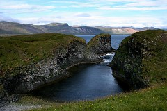 Arnarstapi  - West Fjords - Iceland ({ Planet Adventure }) Tags: iceland icelandiclandscape landscape laterallycool cool stunningscenery verycool incredible wonderful peopleseemtolike favorite facinating supperb stunning travelphotographs worldtraveller traveltheworld travelphotos holidays canoneos eos visittheworld backpacking onflickr flickriscool loveyourphotos havingfun theworldthroughmylenses theworlthroughmyeyes alwaysbecapturing greatcaptures shotingtheworld by{planetadventure} byalessandrobehling ab allrightsreserved tagging beautyissimple icanon icancanon canonrocks canonphotography selftaughtphotographer phographyisart travellingisfun planetadventure canon 20060901 spectacularlandscapes specland placesilove ilovethisplace island islandia inhospitable inhospitableplace ilovenature iwasthere icelandiclandscapeimage awesomelandscape explorer interestingness 100views 200views lindo bleak fantastica cameracraze astar spectacularnature greatcolors beautyfullandscape beautifulscenery geology hit good ratedpro pro 5favs 5faves 5favorites lovephotography flickr copyright20002006alessandroabehling naturalarch arnarstapinaturalarch arnarstapi icelandwestfjords thewest flickrpoker greatformation rockformation excellent perfectpic beautifulcomposition beautifulplace beautifulshot greatcomposition exploremypix xploremypix high5 nicecolors thecontinuum ratemynature cooloutdoorpics interestingplace greatplace visitthisplace perspective 1for10 10to1 4aces creative bliss athumbsup flickrsmille 300views allinteresting 200mostinteresting alliceland justiceland greaticeland visiticeland 20d diversity