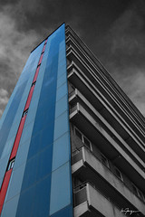 tower block (.fergie) Tags: blue red urban bw colour tower scotland glasgow block accent grovepark tennament geolat55873680 geolon4265769
