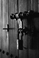 Blast from the past (Ammar Alothman) Tags: door wood old blackandwhite bw history canon flickr gulf lock traditions 2006 kuwait kuwaitcity kw q8 30d  canon30d  3mmar  abigfave kuwaitvoluntaryworkcenter