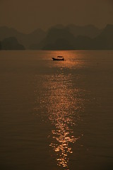 Fishing the sunset (.:. Swinging Girl .:.) Tags: sea sun lake water sunrise boat fishing vietnam halongbay wietnam romanticview surset abigfave