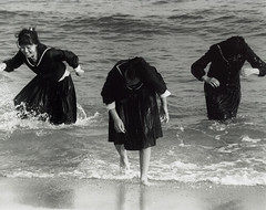 sea you after school (richard thomson) Tags: sea blackandwhite bw 3 film wet topf25 water three triangle uniform geometry korea symmetry nikonf100 explore 35mmfilm busan uniforms southkorea ilford fp4 schooluniform pusan schooluniforms haeundaebeach top20street