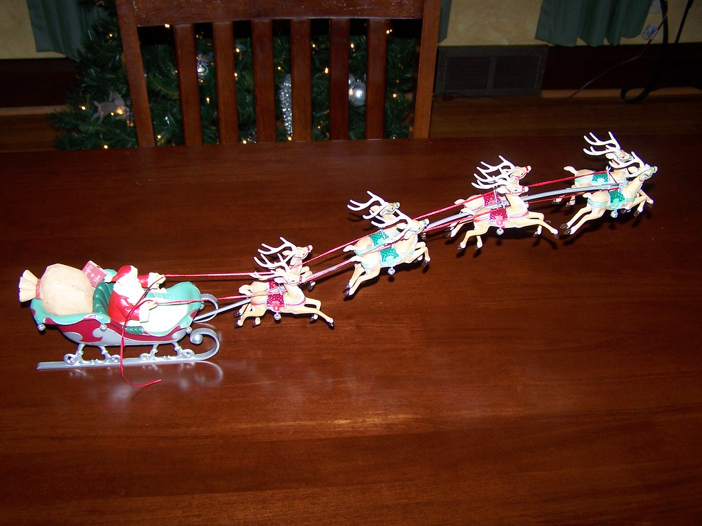 On the dining room table there arose such a clatter, I sprang from the couch to see what was the matter!