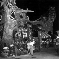 Haunted Castle ride tree facade (King Power Cinema) Tags: darkride panamacitybeach ride hauntedhouse hauntedcastle tracks ghost train ghosttrain haunted funhouse spookhouse vacation tree face attraction fair carnival archive bw darkrides