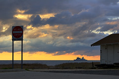 Cape May Ferry (bikeracer) Tags: sunset sky 15fav beach silhouette sign ferry clouds newjersey deleteme10 nj cape capemay shack