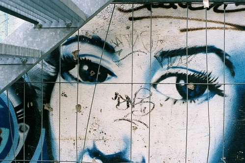 black and white graffiti of eyes watching the viewer