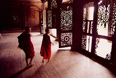 during the monsoon, mandalay (tap tap tap) Tags: burma myanmar monastery monk buddha mandalay woodcarving itsongselection1 mirrorsofsociety itsongnikon6006 excellenceintravelphotography itsongmirrorssoutheastasia