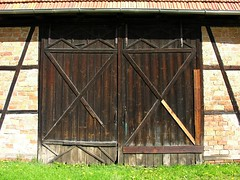 Gate of a barn (:Linda:) Tags: door roof brick grass sunshine architecture barn germany wooden spring gate village timber structure thuringia tr halftimbered browndoor fachwerk fachwerkhaus timberframing hessberg timberconstruction madeofwood braunetr ausholzgemacht holzgegenstand