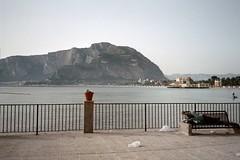 Sunday morning 8am, sleeping on beach bench in Mondello (liberalmind1012) Tags: 2001 italy forsakenpeople sicily mondello