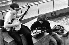 banjo (world_of_noise) Tags: portland pdx bw banjo laptop outside water steps music pioneercourthousesquare pentaxmesuper banjopickin