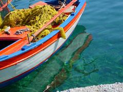Fishing Boat (mnadi) Tags: blue sea sun macro green water colors closeup reflections boats island greek islands boat fishing sailing outdoor turquoise greece lonely nautical closeups kefallonia   nikonstunninggallery