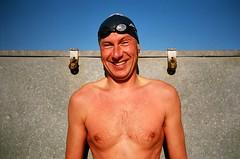 nick relaxing after swim #2 (lomokev) Tags: morning portrait sky beach swim stones nick contax nickb t2 contaxt2 deckchairbox contax050527  deletetag