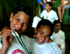 Soraya and Leticia (carf) Tags: girls brazil art boys sport brasil kids children hope dance kid community capoeira child hummingbird traditions esperança social skills folklore philosophy martialarts batizado capoeirabeijaflor beijaflor ecbf