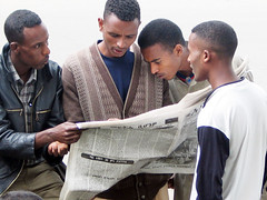 Intensely reading the newspaper in Addis Ababa