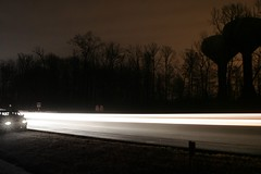 passing me by (littlelakey) Tags: life street tower water night speed jeep warp headlights passing roadside traffice