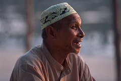 Man in Muslim skullcap with beard chats in late afternoon light on Ko Lanta, Thailand (David Halbakken) Tags: horizontal portrait informal lanta kolanta island thailand asia southeastasia asian andaman andamansea paradise travel leisure vacation tourism people muslim skullcap cap hat brimlesshat brimless ornatehat brimlesscap ornatecap costume animation one male man communication speaking happy emotion expressive personality authority mankind diversity relaxation relationships speak discuss discussion chat style tradition religious religion holiday getaway exhuberance tropical exotic outdoors outside lifestyle vitality unity alert charming foreign intense international interconnected inspiration passion whiskers tropics composure culture emotive energy enjoyment entertain expression express face facial facialexpression faraway folk friendship fun happiness headdress innerstrength ornament ornamental orient oriental peaceful person picturesque playful pluck poise society thai traditional