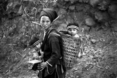LAOS - Yao Family (BoazImages) Tags: bw woman baby black hat topv111 children women asia forsakenpeople tribal laos yao indigenous