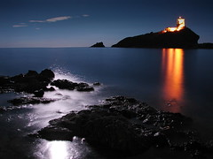 Seascape of the harvest moon (LucaPicciau) Tags: sardegna sea moon lighthouse seascape tower night island bravo long mare sardinia torre quality luna fullmoon nora harvestmoon notte pula isola santefisio lupi spectnight lupi75 abigfave p1f1 coltellazzo artoflight nocturnalmasterpiece