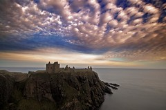 Dunnotar Castle Revisited (bgladman) Tags: ocean uk travel sunset sea sky colour castle clouds spectacular landscape photography coast scotland photo nikon ruins d70 stock scenic dramatic escocia cliffs explore coastline colourful nikkor hdr highdynamicrange stonehaven schottland dunnotar scozia cosse tonemapped interestingness199 i500   abigfave bgladman  brendangladman