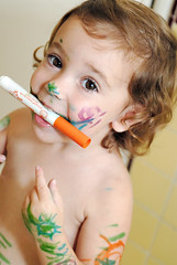 um, yeah, she loves her new markers... (sesame ellis) Tags: orange green girl toddler play mykid marker year2