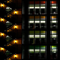 auto park - 1 (♫ marc_l'esperance) Tags: light red orange abstract black detail green geometric lines yellow vertical horizontal architecture night vancouver composition contrast canon dark eos lights bars downtown colours shadows parkinggarage geometry abstractart quality © shapes angles 2006 architectural diagonal 10d slowshutter abstraction parkade parallel levels notripod allrightsreserved angled cml gvrd diagonals thegallery intersecting canonef70200mmf28lusm ef70200mmf28l canon70200f28l artificialillumination abigfave lightofnight