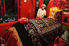 Keeper of a holy coffin (Bobulix) Tags: pakistan red shrine muslim islam tomb coffin sufi sehwan lalshahbazqalander