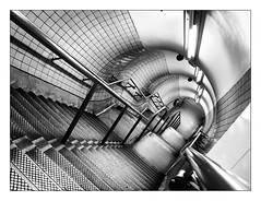 Inside London (brunoat) Tags: blackandwhite bw london blancoynegro stairs underground subway bravo metro quality tube staircase londres escaleras lmff lmff1 lmff2 lmff3 lmff4 brunoat impressedbeauty themostphotogenicstaircaseonthetube 20espacios brunoabarca