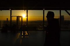 man at dusk (adversegecko) Tags: light shadow sky sun man glass silhouette yellow skyline landscape lights ramp dusk leeds trainstation silhoutte sihoutte leedstrainstation