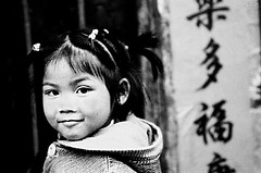 CHINA (BoazImages) Tags: life china portrait blackandwhite bw black girl topv111 pretty chinese script miao ethnic