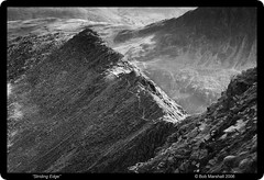 Striding Edge from Helvellyn (Bob Marshall 1) Tags: uk mountain lake monochrome mono rocks district lakedistrict rocky edge cumbria bm stridingedge helvellyn striding interestingness298 i500 specland